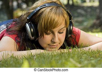 woman listening to music - beautiful happy woman listening...