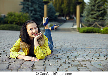beautiful happy woman lying on the ground