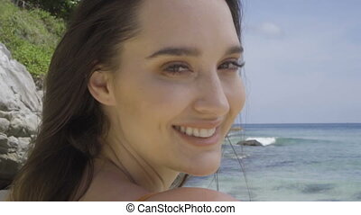 Beautiful happy woman on the beach
