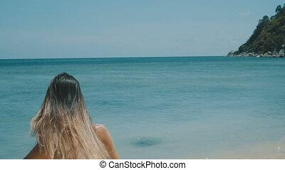Beautiful happy woman on the beach