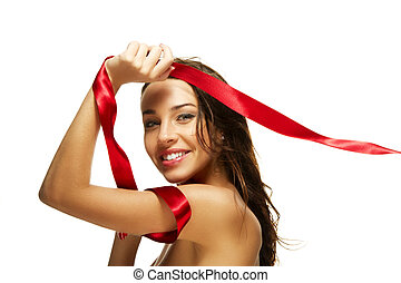 beautiful happy woman playing with a red ribbon on white background