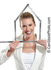 beautiful happy woman showing an house symbol