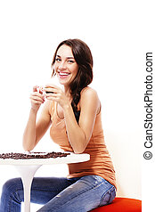 beautiful happy woman sitting on a table with espresso coffee on white background