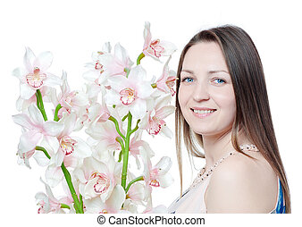 Beautiful happy woman with orchid flower over white background