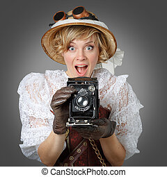 Beautiful happy woman with retro camera. Steampunk.