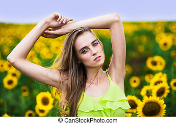 Beautiful happy woman with sunflowers outdoors