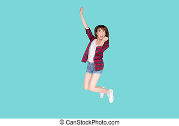 Beautiful happy young asian woman jumping with expression fun, enjoy and cheerful while travel in summer, asia girl excited with freedom in weekend in holiday, trip and tourism fashion concept.