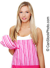 Beautiful happy young blond woman wearing kitchen apron