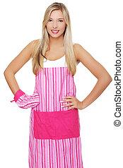 Beautiful happy young blond woman wearing kitchen apron,...