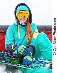 Beautiful happy young snowboarder girl with snowboard.