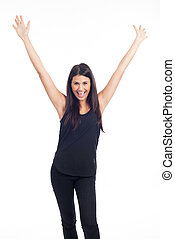 beautiful happy young woman in black dress and hands in the air