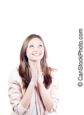 Beautiful happy young woman praying