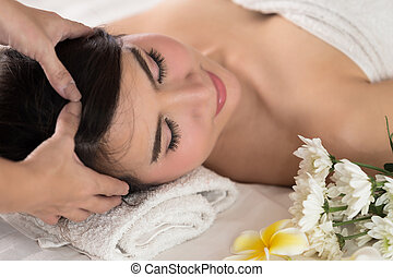 Beautiful, healthy and young woman is getting spa treatment.