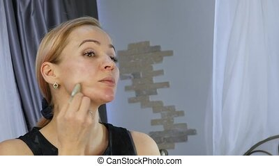 Beautiful healthy woman doing oil face massage. Health and...