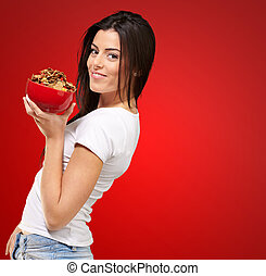 Healthy Woman Holding Bowl Of Cornflakes