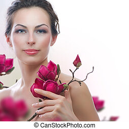 Beautiful Healthy Woman with Spring Flowers. Spa