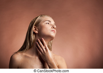 Beautiful healthy woman with wet face and drops of water
