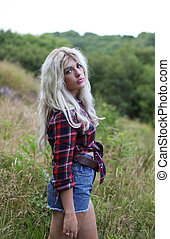 Beautiful healthy young woman outdoors wearing casual clothers