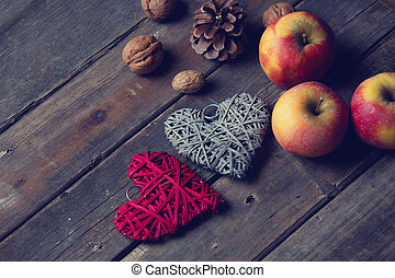 beautiful heart shaped toys, cones and nuts on the wonderful brown wooden background