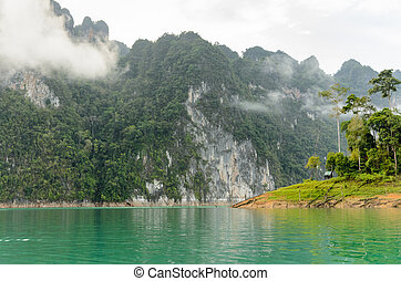 Beautiful high mountains and green lake in morning at...