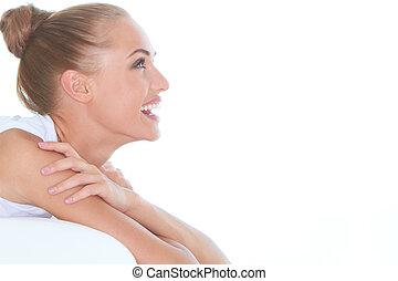 Beautiful high-spirited woman laughing - Closeup facial...