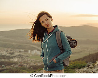 Beautiful hiker young woman with backpack outdoor