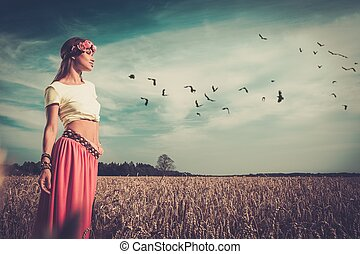 Beautiful hippie girl in a field