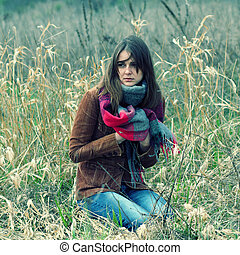 beautiful hipster girl in a field