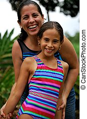 Beautiful Hispanic mother and daughter