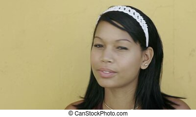 Beautiful hispanic teen smiling