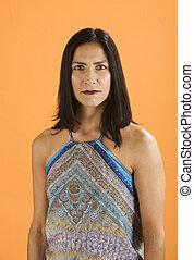 Beautiful Fit Hispanic Woman on Orange background