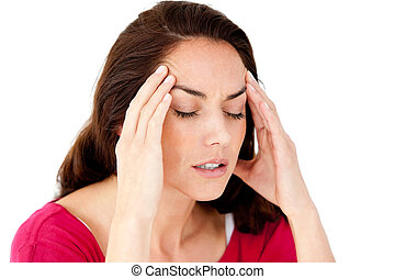 Beautiful hispanic woman having a headache against a white background