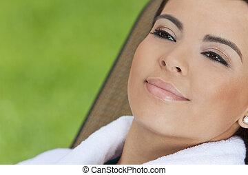 Beautiful Hispanic Woman in White Bathrobe At Health Spa