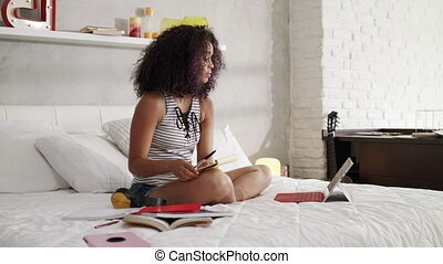 Beautiful Hispanic Woman Studying At Home With Laptop Pc