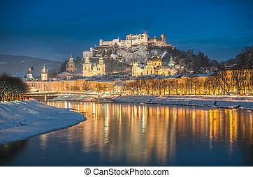 Beautiful historic city of Salzburg in winter at night,...