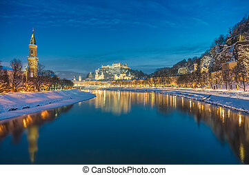 Beautiful historic city of Salzburg in winter at night,...