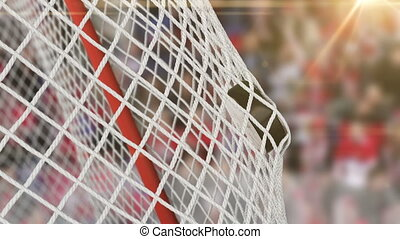 Beautiful Hockey Puck flies into Goal Net in Slow Motion with Fans Background. Hockey 3d animation of the Close-up Goal Moment. Sport Concept. 4k Ultra HD