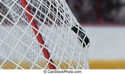 Beautiful Hockey Puck Flies into Goal Net in Slow Motion...