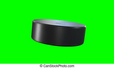 Beautiful Hockey Puck Rotating Close-up in Slow Motion on Green Screen and Black Background. Looped Hockey 3d Animation of Turning Puck Isolated Alpha Matte. Sport Concept. 4k Ultra HD 3840x2160.
