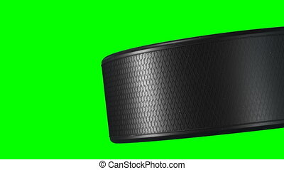 Beautiful Hockey Puck Rotating Close-up in Slow Motion on Green Screen. Looped Hockey 3d Animation of Turning Puck Isolated Alpha Matte. Sport Concept. 4k Ultra HD 3840x2160.
