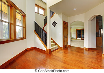 Beautiful home entrance with wood floor. New luxury home interior.