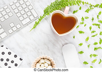 Beautiful home office workspace with heart-shaped teacup