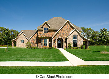 A beautiful home or house on a sunny day, constuction industry, real esate or architecture concept