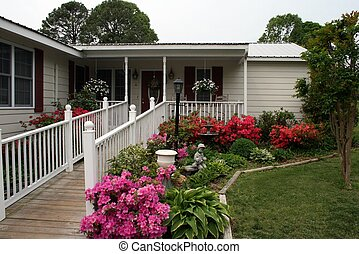 a beautiful ranch home with handicap ramp in front - landscaped home with handicap ramp blending in to look almost natural