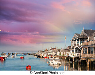 Beautiful homes of Nantucket, Massachusetts. Houses over water at dusk