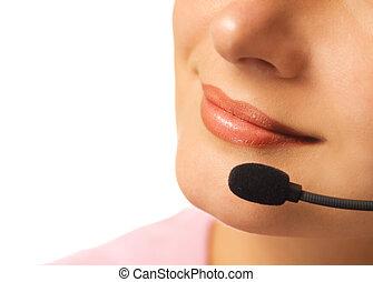 Beautiful hotline operator with headset isolated on white background