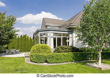 Beautiful house exterior in large garden
