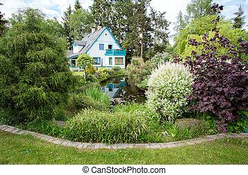 Beautiful house in spring garden