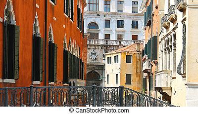 Beautiful houses on a narrow street in Venice, Italy