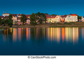 beautiful houses on the river bank at sunset